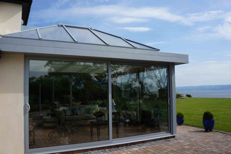 Aluminium conservatories cardiff valuefold for Conservatory sliding doors